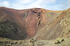 Colored earth of a crater Stock Images