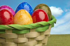 Colored easter egg basket with blue sky Royalty Free Stock Photos