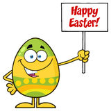 Colored Easter Egg Cartoon Mascot Character Holding A Blank Sign Royalty Free Stock Photography