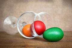 Colored Easter egg in the wineglass, grunge background Royalty Free Stock Images