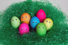 Colored Easter Eggs. Bunch of colored Easter eggs in grass stock photos