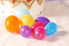 Colored easter eggs. A variety of small, pastel colored easter eggs on a soft, white background Stock Image