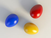 Colored Easter eggs. Three colored eggs ready for Easter holidays Royalty Free Stock Photos