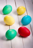 Colored easter eggs. On white board Stock Photos