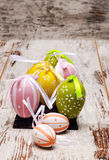 Colored Easter eggs. Surrounded by rustic background Stock Photography