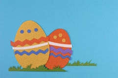 Colored easter eggs. Colorful eggs with grass on a blue background royalty free illustration