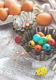Colored easter eggs and baking molds on a light canvas background,place for text Royalty Free Stock Image