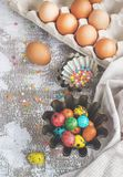 Colored easter eggs and baking molds on a light canvas background,place for text Royalty Free Stock Images