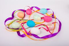 Colored Easter eggs. Among the bands Stock Image