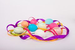 Colored Easter eggs. Among the bands Stock Photography