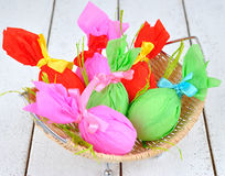 Colored Easter eggs in basket Stock Images