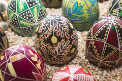 Colored Easter eggs in a basket Royalty Free Stock Photos