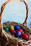Colored Easter eggs in the basket.  stock photo