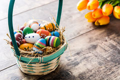 Colored easter eggs in a basket Royalty Free Stock Photo