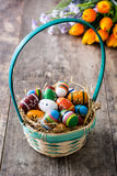 Colored easter eggs in a basket Stock Image