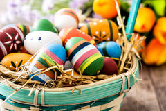 Colored easter eggs in a basket Royalty Free Stock Images