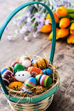 Colored easter eggs in a basket Stock Photography
