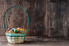 Colored easter eggs in a basket Stock Photos