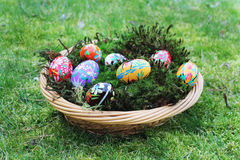Colored easter eggs in basket Stock Photo