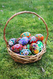 Colored easter eggs in basket Royalty Free Stock Photo