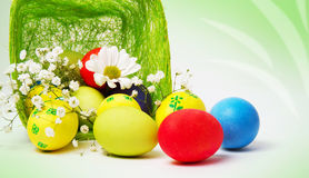 Colored Easter eggs and basket Stock Image