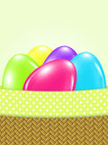 Colored easter eggs in basket. With place for text Royalty Free Stock Photos