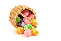 Colored Easter eggs in a basket Stock Images