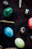 Colored Easter eggs on black metal background stock photos