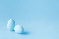 Colored easter eggs on blue background stock image