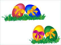 Colored easter eggs with bows. In the grass Royalty Free Stock Photos