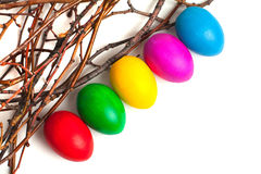 Colored Easter eggs from the branches. On a white background Stock Photos
