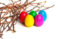 Colored Easter eggs from the branches. On a white background Stock Photo
