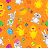 Colored Easter eggs, bunnies, baskets, flowers, Royalty Free Stock Photography
