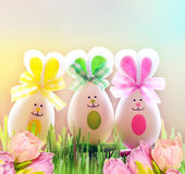 Colored easter eggs bunny on grass and flowers. Colored easter eggs bunny on green grass and flowers Royalty Free Stock Images