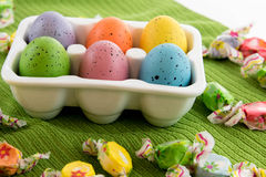Colored Easter eggs, candy and decorations Royalty Free Stock Image