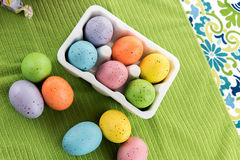 Colored Easter eggs, candy and decorations Stock Photos