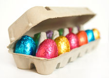 Colored Easter eggs in carton Stock Images