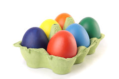 Colored Easter eggs in carton over white. Colored Easter eggs in carton Stock Photo