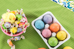 Colored Easter eggs, chick and candy Stock Photography