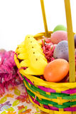 Colored Easter eggs, chicks, candy and basket Royalty Free Stock Image