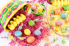 Colored Easter eggs, chicks, candy and basket Royalty Free Stock Photos