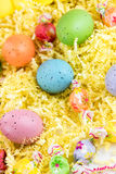 Colored Easter eggs, chicks and candy Stock Photos
