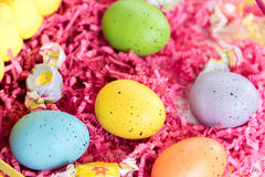 Colored Easter eggs, chicks and candy Royalty Free Stock Photo