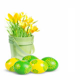 Colored Easter eggs and crocuses Stock Photo