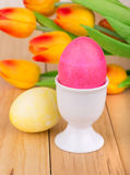 Colored Easter Eggs and Cup Stock Photos