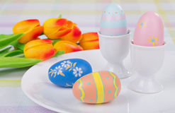 Colored Easter Eggs and Cups Royalty Free Stock Photo