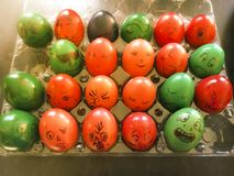 Colored Easter eggs decorated with funny faces. As a spin off the Romanian Easter tradition for some family entertainment Royalty Free Stock Photo