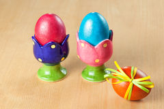 Colored easter eggs in egg cups Stock Image