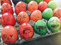 Colored Easter Eggs with funny faces. Our family spin off the Romanian tradition of colored Easter Eggs. After boiling and coloring the eggs, all of us will draw Stock Images