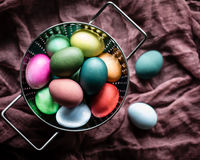 Colored Easter Eggs. Gorgeous, multicolored easter eggs in a stainless steel strainer Royalty Free Stock Photo